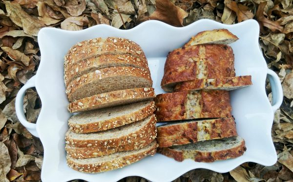 whole grain bread, bread in a white dish, hearty loaves of bread, healthy bread, home tastes like whole bread